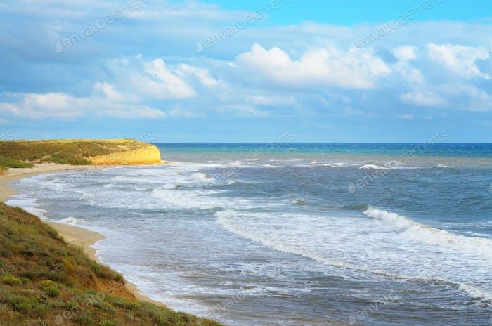 Waves running to coast at ocean beach summer time