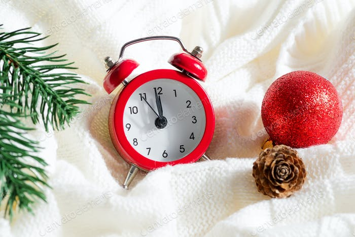 Christmas set with alarm clock and holiday decoration
