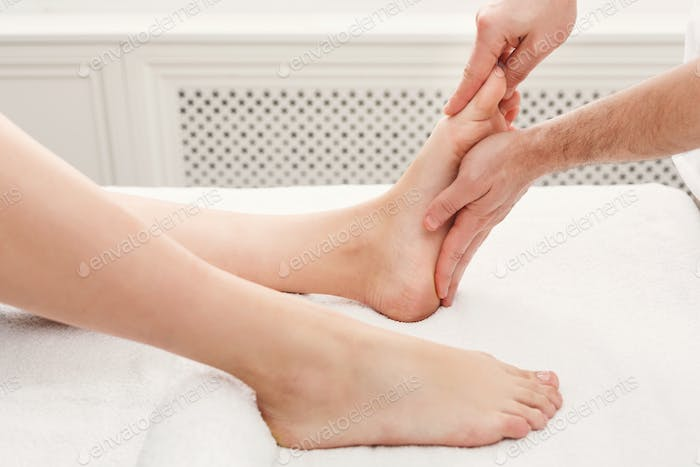 Feet massage closeup, acupressure