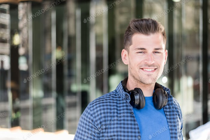 Man close up with headphones smiling