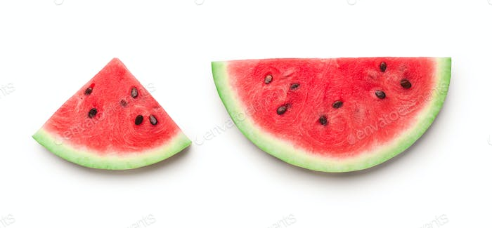 Semicircle and triangle shaped ripe watermelon slices isolated