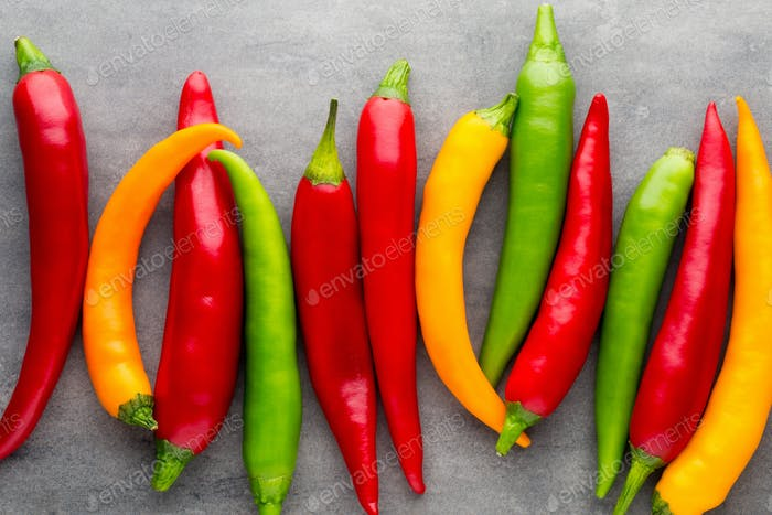 Chilli pepper on the grey background.