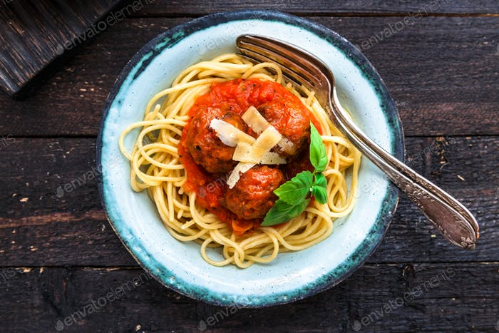 Itallian spaghetti and meatballs and parmegano for dinner, comfort food, close view