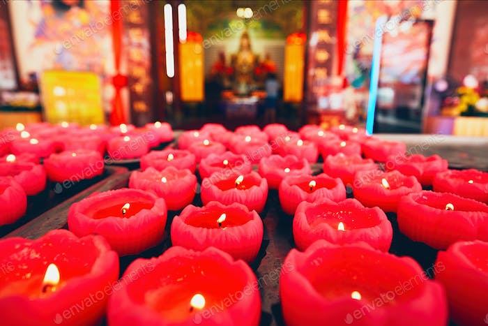 Burning candles in Chinese temple