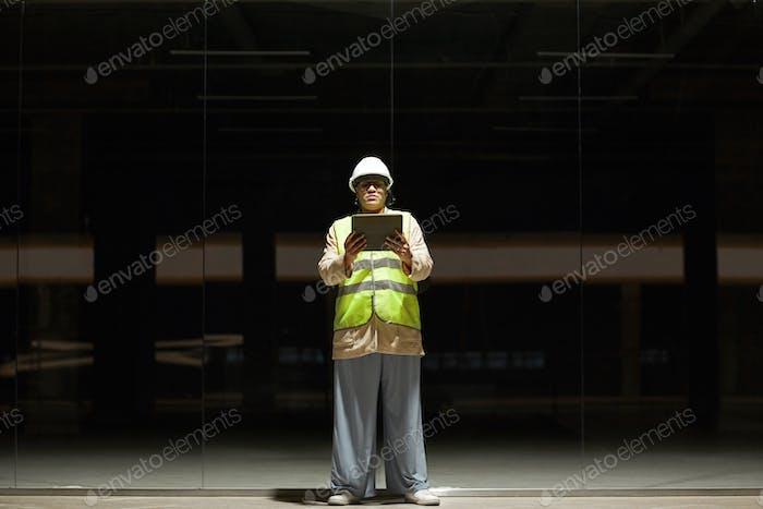 Female Engineer Inspecting Basement
