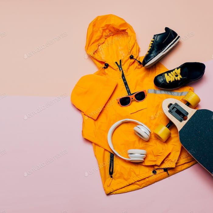 Jacket, headphones, skateboard. Urban style. Street Outfit