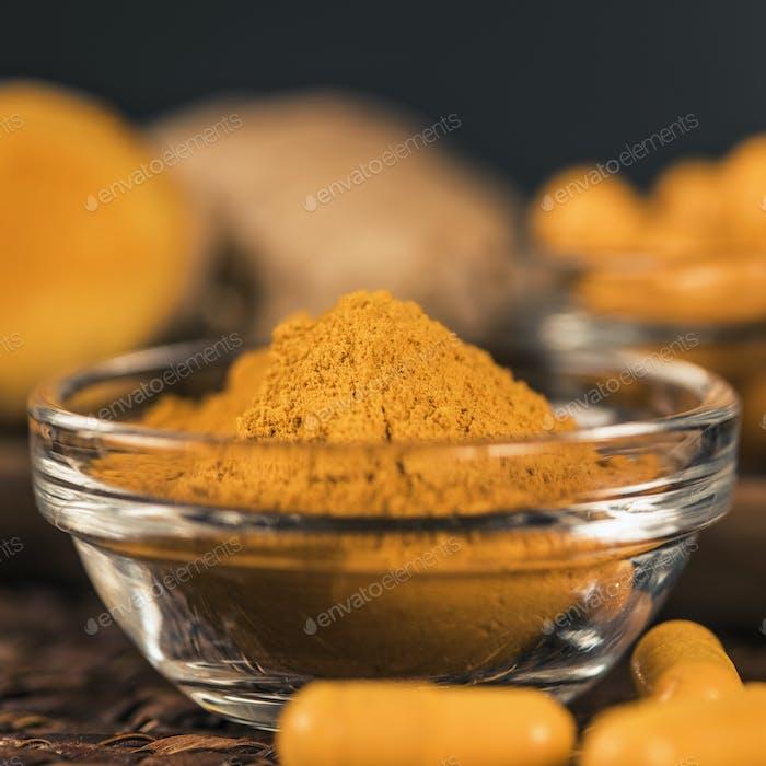 Turmeric Powder and Curcumin Herbal Supplement Capsules