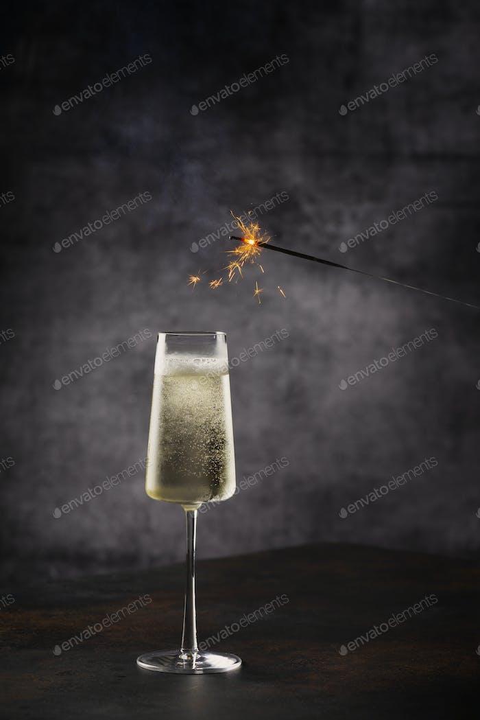 Glass og champagne with sparklers light