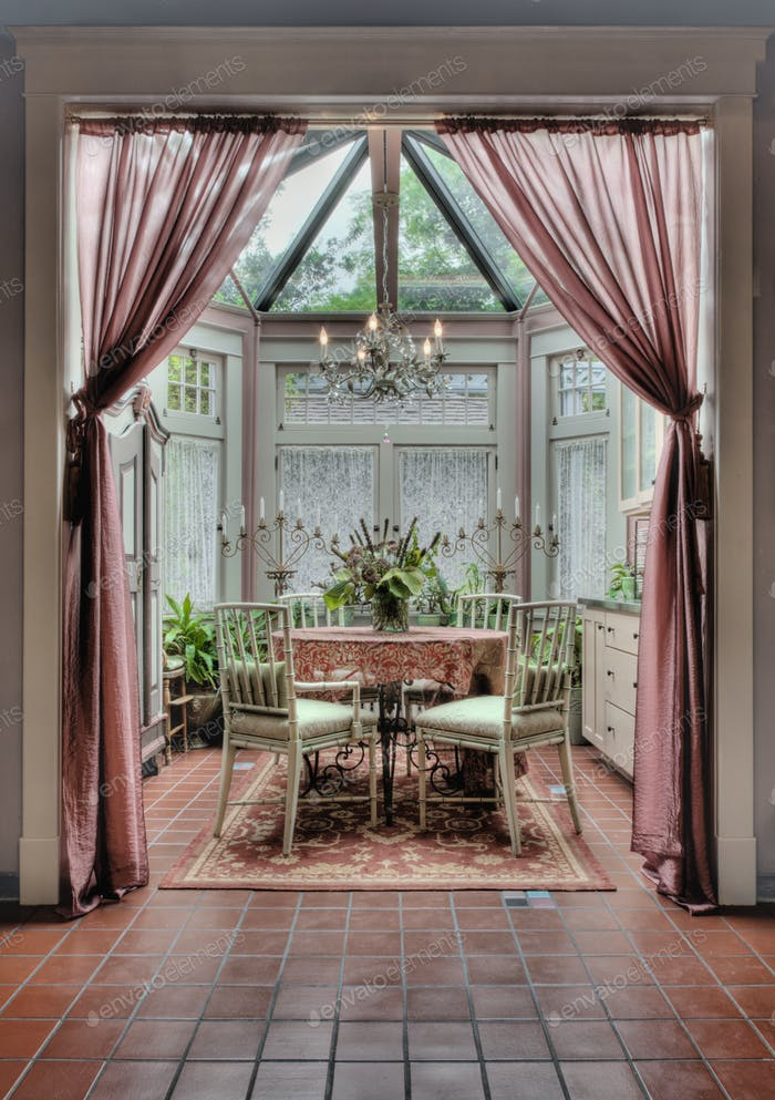 54596,Curtains and dining table in ornate dining room