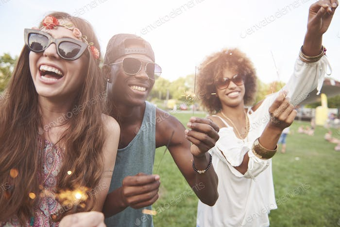 Young and happy people with sparklers