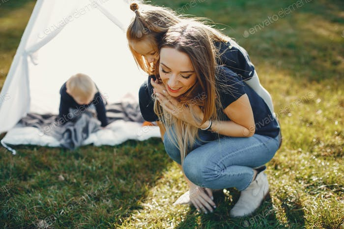 Mother with children playing in a summer park