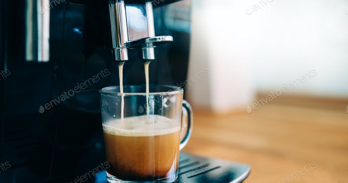 Coffee machine making coffee in morning with crema