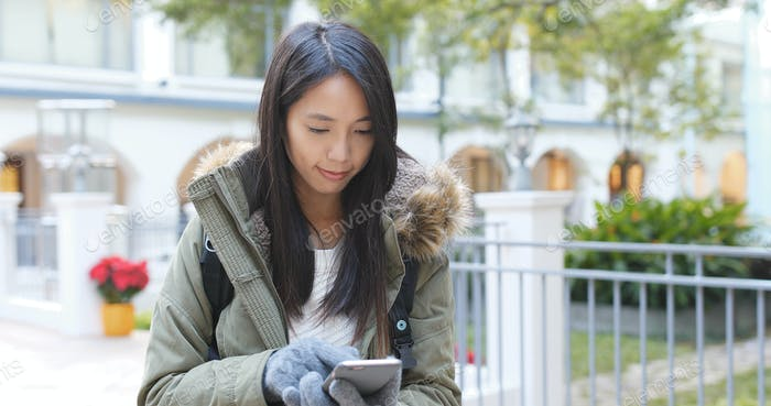 Woman use of smart phone with wearing knit glove