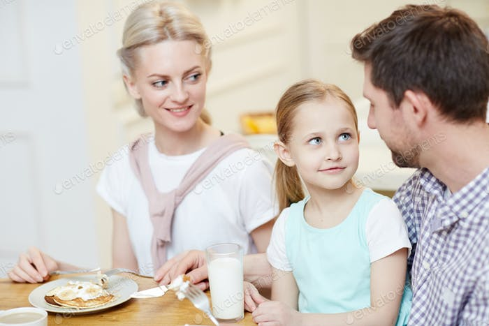 Cute daughter listening to father