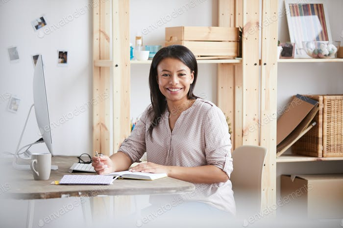 Smiling Mixed Race Woman at Desk