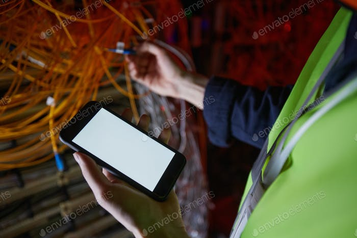Technician Testing Power in Computer Network
