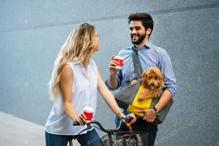 Friends, students and happiness concept. Happy people drinking coffee and talking on city street