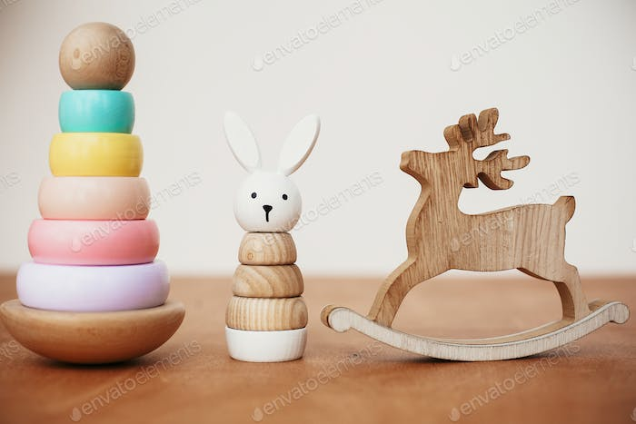 Stylish wooden toy for child on wooden table