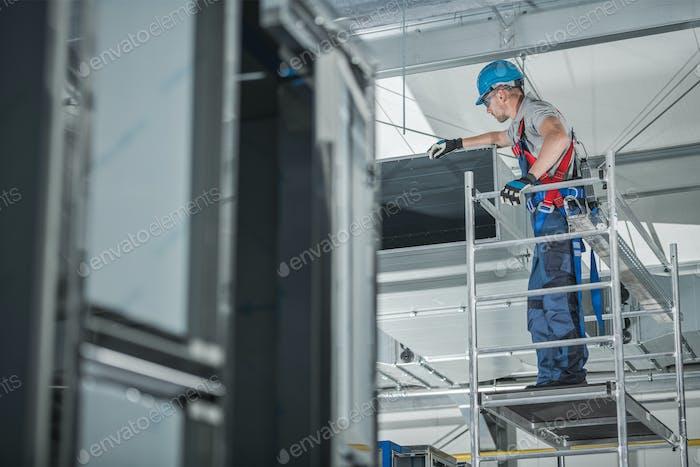 Air Ventilation Technician Checking Installed Shaft.
