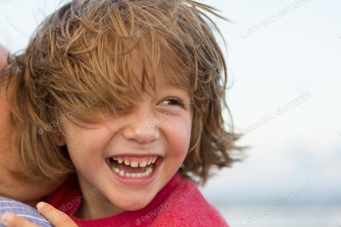 smiling 5 year old boy at the beach