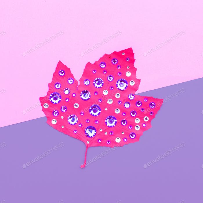 Art gallery. Autumn colored leaf in rhinestones Candy colors