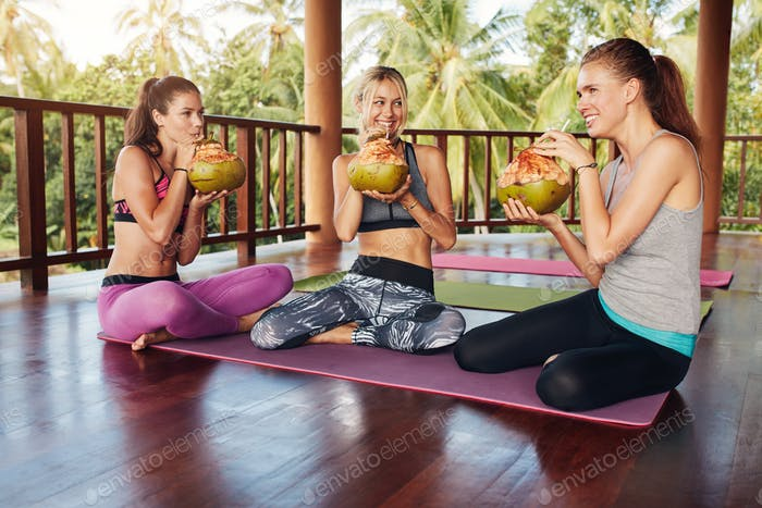 Group of people drinking coconut juice at yoga class