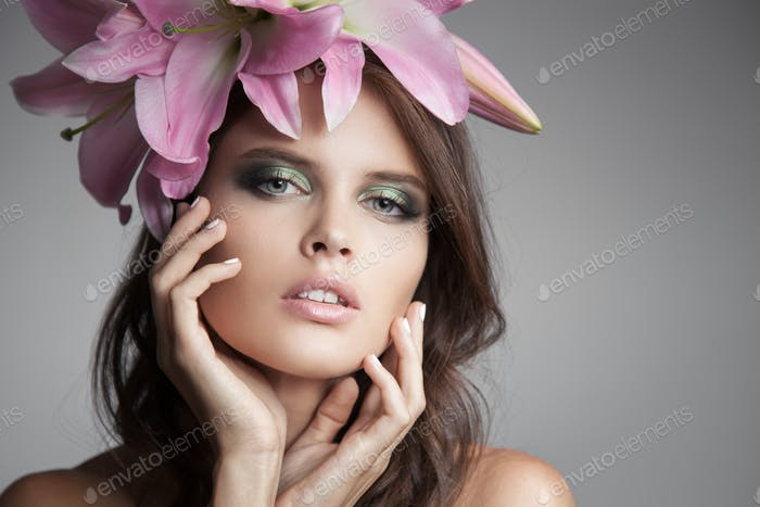 Beautiful Woman With Flowers Wreath In Her Hair. Pink Lily.