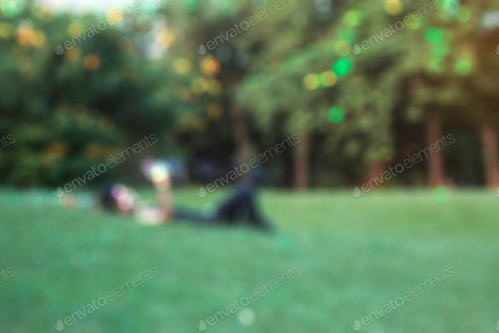 Men on lawn with blurred images