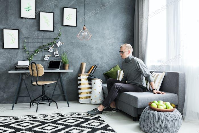 Man in flat apartment