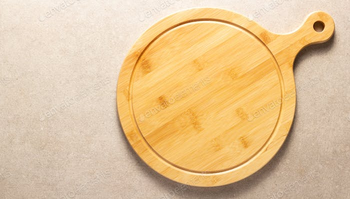 Pizza or bread cutting board for homemade baking on table. Food recipe concept