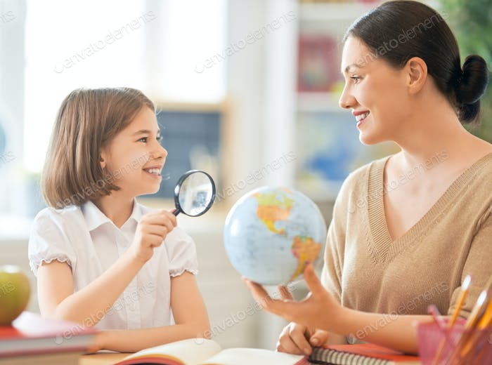 Girl with teacher in classroom.