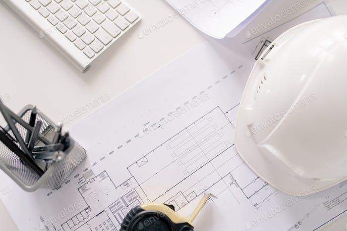 Overview of working supplies of contemporary engineer on desk