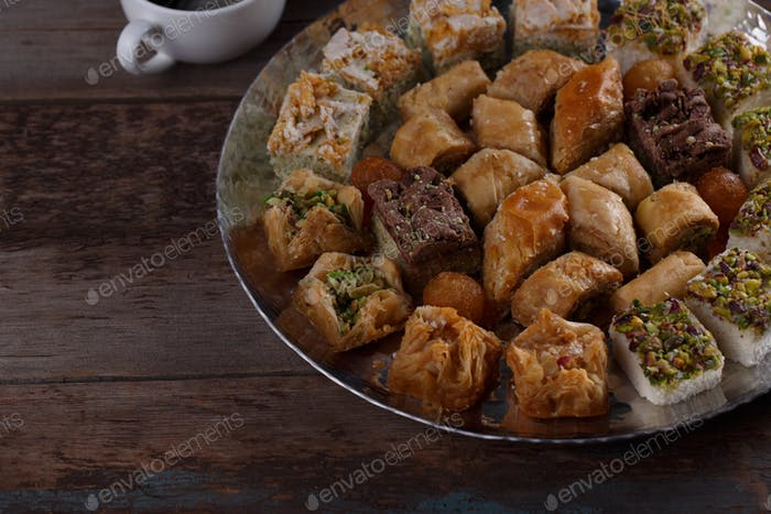 Close view of baklava and turkish delights on silver tray