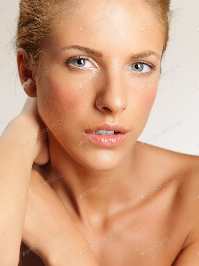 closeup beauty portrait of young, blonde woman