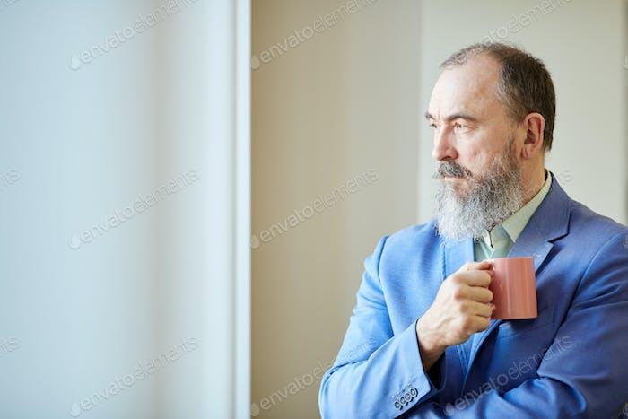Senior Businessman Looking Away
