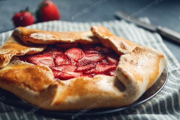 Open sweet pie galette with fresh strawberry.