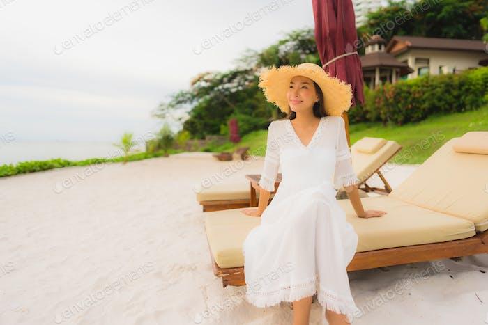 Portrait beautiful asian woman wear hat with smile happy leisure