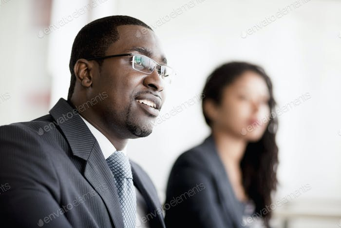 Smiling businessman listening at a business meeting