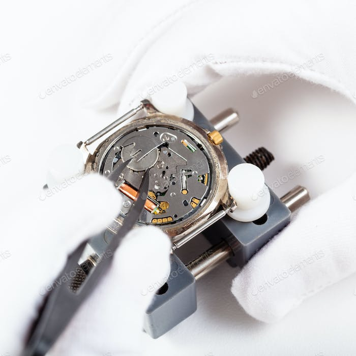 replacing battery in quartz wristwatch close up