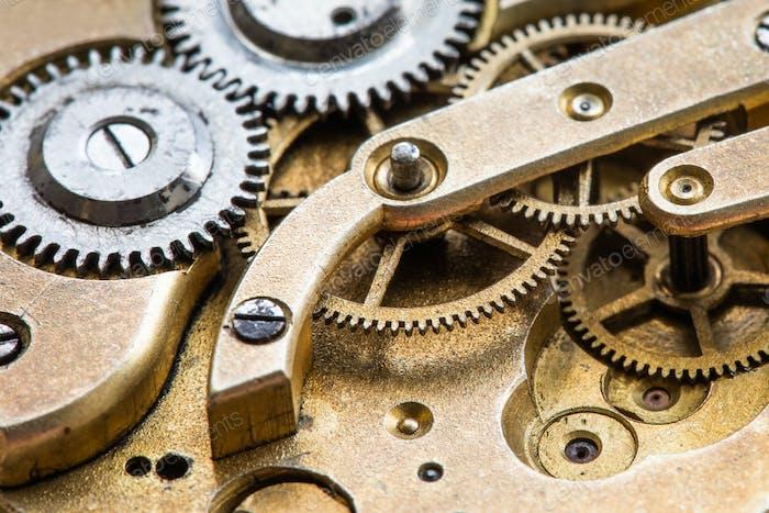 Old pocket watch clock transmission macro view.