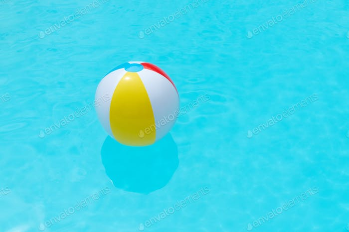 Beach Ball Floating on water surface of a swimming pool