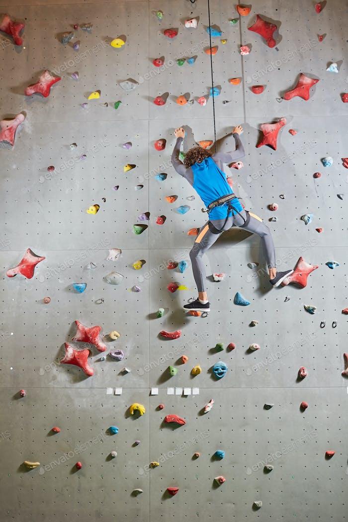 Man on climbing wall