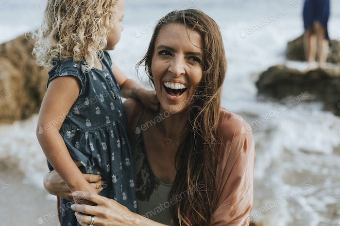 Mom with young daughter at a beach