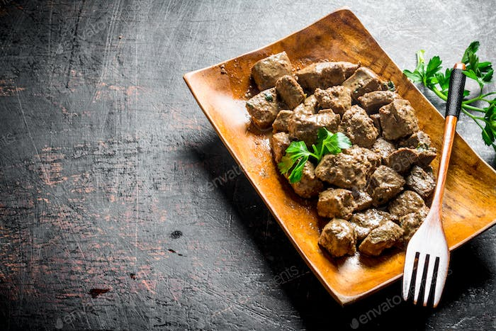 Fried liver with parsley.