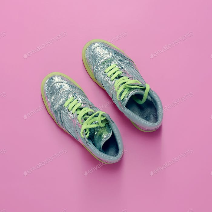 Glamorous sneakers on pink background. Vanilla fashion style