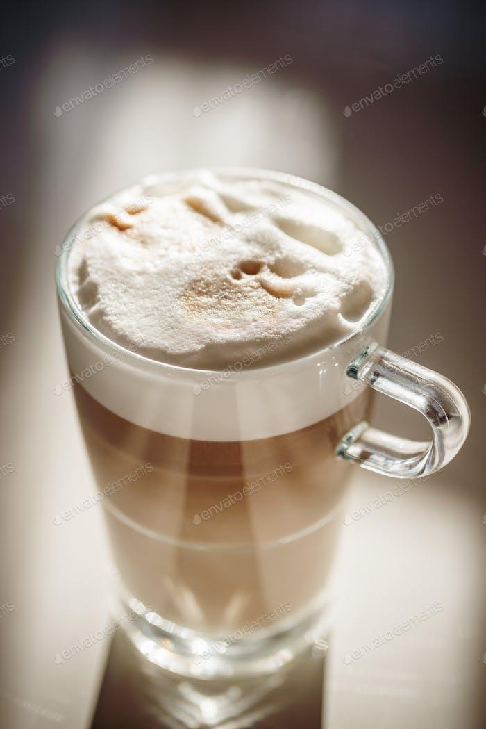 Glass with latte macchiato
