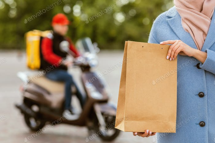 Customer Girl Holding Delivered Food Package Standing Outdoors, Cropped
