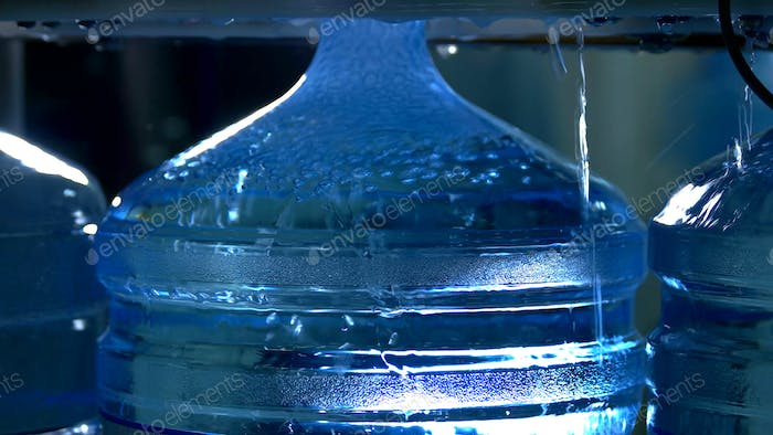 Bottle being filled with water.
