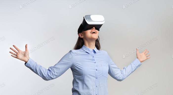 Excited Businesswoman Experiencing Virtual Reality On White Background, Panorama