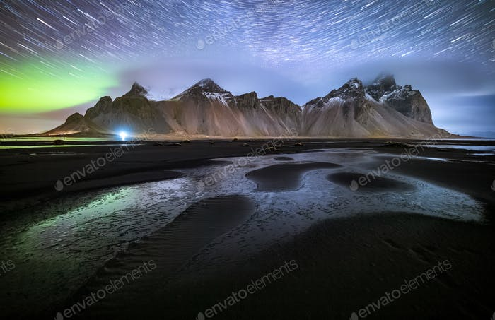 Vestrahorn mountain with Aurora borealis and startrails, Stokksnes, Iceland